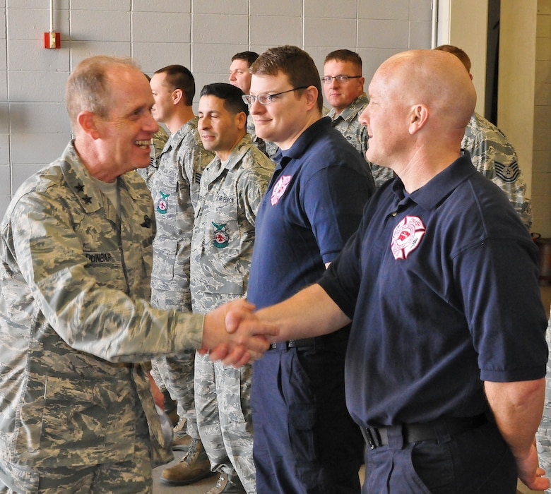 Maj. Gen. Donald P. Dunbar, the adjutant general of Wisconsin greets Scott Mettlach of the 128th Air Refueling Wing Fire Department, Milwaukee, on a planned tour during the unit training assembly April 6, 2014. (U.S. Air National Guard photo by SSgt. Jeremy M. Wilson/Released)