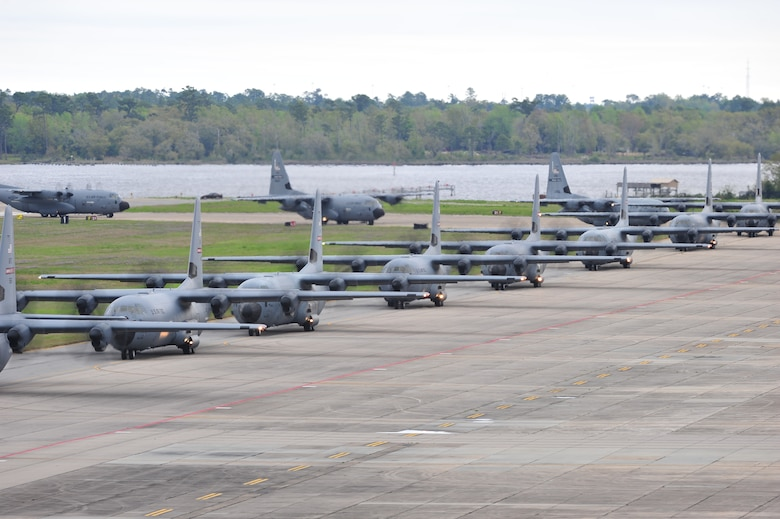 A line of C-130J aircraft from the 815th and 345th and WC-130J aircraft from the 53rd Weather Reconnaissance Squadron taxi onto the runway before takeoff for Operation Surge Capacity here April, 5, 2014.  Sixteen aircraft from the 403rd Wing took part in a large scale training exercise designed to test the wing's abiltiy to launch and recover a large formation of aircraft and to execute airdrops.  (U.S. Air Force photo/Tech. Sgt. Ryan Labadens)