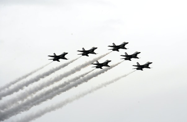 The U.S. Air Force Thunderbirds perform aerial acts during the Wings Over Columbus 2014 Open House and Airshow at Columbus Air Force Base, Miss., April 6, 2014. Although the open house was cut short due to bad weather, all aerial performers completed their acts. (U.S. Air Force Photo/Senior Airman Kaleb Snay)