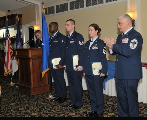 SCOTIA, N.Y. -- Senior Airman Kylief Tucker, Airman of the Year, Tech. Sgt. Robert Harrington, NCO of the Year, and Master Sgt. Amanda Blodgett, First Sergeant of the Year, were all honored during the 109th Airlift Wing's annual Airmen of the Year Dinner on April 4. Chief Master Sgt. Mark Mann (right) accepted the award for Senior Master Sgt. Patrick FitzGerald (not pictured), Senior NCO of the Year. Tucker is assigned to the 109th Maintenance Squadron, Harrington is assigned to the 109th Communications Flight, Blodgett is assigned to the 109th Logistics Readiness Squadron, and FitzGerald is assigned to the 109th Small Air Terminal. (Air National Guard photo by Master Sgt. William Gizara/Released)