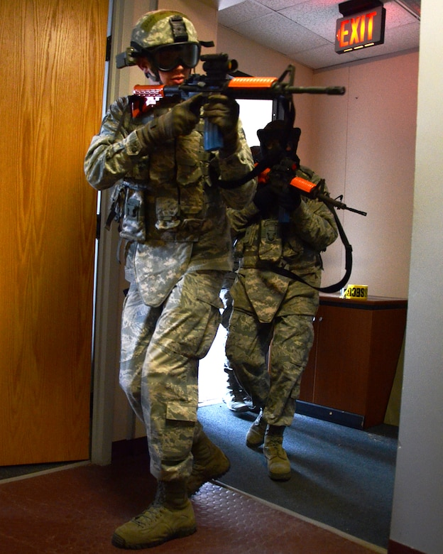 PEASE AIR NATIONAL GUARD BASE, N.H. -- U.S. Air Force Senior Airman Stephen Drown, front, and Senior Airman Riley Burley, 157th Security Forces Squadron, N.H. Air National Guard, enter a building during an active shooter training exercise at Pease Air Force Base April 5, 2014. The previously scheduled training comes just days after a gunman killed three people and injured 16 at Fort Hood in Texas. Active shooter events at military installations over the past several years have resulted in the Installation Exercise Program Office designing an active shooter scenario and integrating into the training schedule. (N.H. National Guard photo by Tech. Sgt. Mark Wyatt/RELEASED)