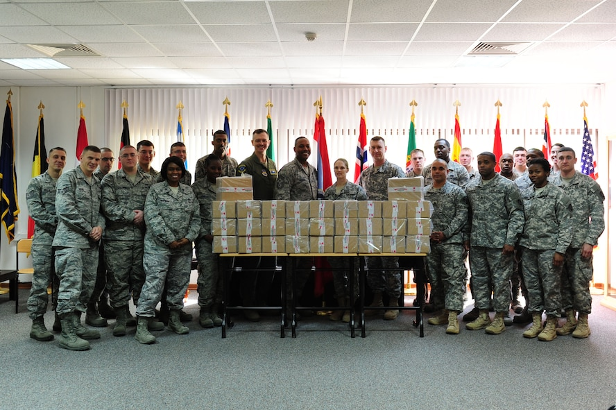 Airman Leadership School students pose for a group photo March 14, 2014, Incirlik Air Base Turkey.   The class donated 360 donuts to U.S. Army 5-7 Air Defense Artillery Soldiers in Gaziantep, Turkey. (U.S. Air Force photo by Senior Airman Nicole Sikorski/Released)