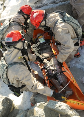 Members of the Oregon National Guard's CBRNE Enhanced Response Force Package (CERFP), free a simulated victim that was trapped during the Vigilant Guard-Alaska 2014 exercise, near Joint Base Elmendorf-Richardson, Anchorage, Alaska, March 29, 2014. (U.S. Air National Guard photo by Tech. Sgt. John Hughel, 142nd Fighter Wing Public Affairs/Released)