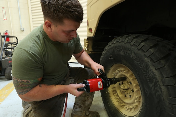 Lance Cpl. Nickolas Barker, from Kingsford, Mich., and an automotive maintenance technician with Combat Service Support Company, I Marine Expeditionary Force Headquarters Group removes a tire on a High Mobility Multipurpose Wheeled Vehicle aboard Camp Pendleton, April 3, 2014. The Marines rose the readiness percentage by 20 percent over a month.