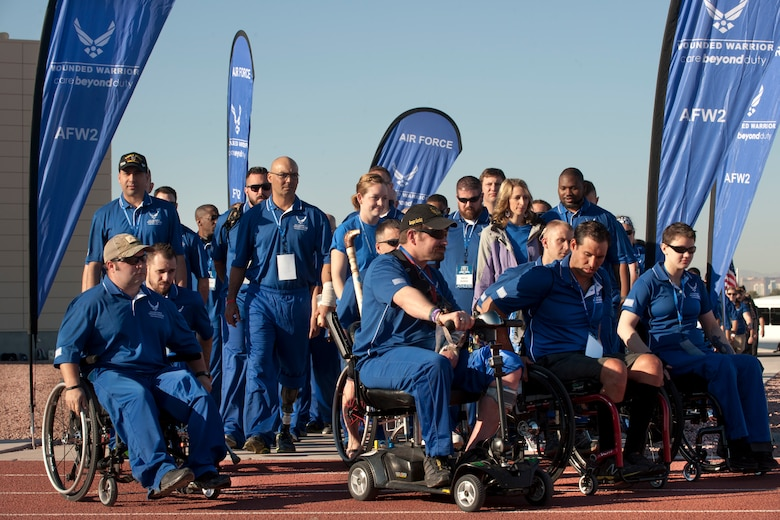 Wounded warrior athletes walk onto the field April 7, 2014, at the Warrior Fitness Center track at Nellis Air Force Base, Nev., as part of the Air Force Wounded Warrior Trials.The trials are an adaptive sports camp used to identify which athletes will be selected as members of the Air Force Warrior Games team and compete against other military branches September 2014. (U.S. Air Force photo/Senior Airman Matthew Lancaster)