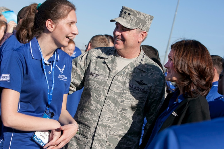Air Force Chief of Staff Gen. Mark A. Welsh III and his wife, Betty Welsh, speak with Ramina Oraha April 7, 2014, at Nellis Air Force Base, Nev. Oraha will be competing in the an Air Force Wounded Warrior Trials. (U.S. Air Force photo/Lorenz Crespo)