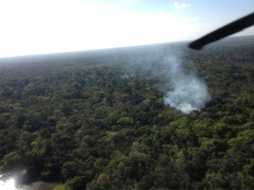 A marijuana field burns during a joint marijuana eradication operation between Joint Task Force-Bravo and Belizean forces.  The operation, which lasted March 15-20, 2014, resulted in the Belizean government destroying 34 marijuana fields and approximately 57,283 mature marijuana plants for an initial estimated value of $29 million.  In addition, the team also found and destroyed 25 pounds of marijuana seeds.  Joint Task Force-Bravo provided aviation support, on-call casualty evacuation and caving ladder training for 52 Belizean personnel who participated in the operation.  (Courtesy photo)