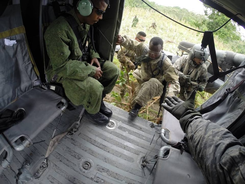 Belizean forces board a U. S. Army UH-60 Blackhawk helicopter to search for marijuana fields in Belize during the marijuana eradication mission.  The operation, which lasted March 15-20, 2014, resulted in the Belizean government destroying 34 marijuana fields and approximately 57,283 mature marijuana plants for an initial estimated value of $29 million.  In addition, the team also found and destroyed 25 pounds of marijuana seeds.  Joint Task Force-Bravo provided aviation support, on-call casualty evacuation and caving ladder training for 52 Belizean personnel who participated in the operation.  (Courtesy photo)