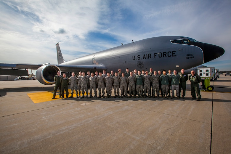 Cadets from Detachment 750, Air Force ROTC, St. Joseph's University, and pilots and boom operators with the 108th Wing, New Jersey Air National Guard, pose for a group photo in front of a KC-135 Stratotanker at Joint Base McGuire Dix-Lakehurst, N.J., after a refueling mission April 2, 2014. The orientation flight gave the 25 Air Force ROTC cadets an opportunity to observe the pilots and aircrew perform their jobs in a real world environment. (U.S. Air National Guard photo by Master Sgt. Mark C. Olsen/Released)