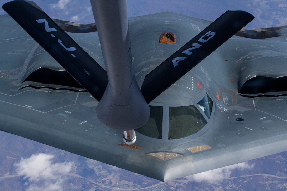 A 108th Wing KC-135 Stratotanker with the New Jersey Air National Guard, assigned to Joint Base McGuire Dix-Lakehurst, N.J., refuels a B-2 Spirit bomber April 2, 2014. The air refueling mission provided 25 Air Force ROTC cadets from Detachment 750, St. Joseph's University, Philadelphia, Pa., the opportunity to observe the mission as part of the 108th Wing's orientation flight program. The orientation flight offers the cadets an opportunity to observe the pilots and aircrew perform their jobs in a real world environment. The B-2 Spirit, which is part of Air Force Global Strike Command is a multi-role bomber capable of delivering both conventional and nuclear munitions, is stationed at Whiteman Air Force Base, Mo. (U.S. Air National Guard photo by Master Sgt. Mark C. Olsen/Released)