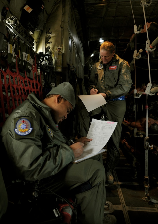 Capt. Elizabeth Norris, flight nurse and Staff Sgt. Sean McCurbin, aeromedical technician, document simulated patient treatment in the air during a national disaster exercise, Ultimate Caduceus 2014, at Cheyenne Air National Guard Base, Wyo., March 31, 2014. During Ultimate Caduceus, part of the Federal Emergency Management Agency's National Capstone Exercise, AE members provided medical support, processed and transferred patients. The aeromedical teams were comprised of more than 18 AE crew members from Pope Army Airfield, N.C., Scott AFB, Ill., and Cheyenne ANG base, Wyo. (U.S. Air Force photo/ Staff Sgt. Stephenie Wade)