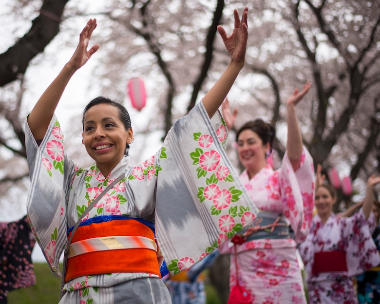 Arlen Paola, a Yokota Air Base spouse performs a tanabata dance in a traditional Japanese Yukata outfit during the Fussa Sakura Festival in Fussa City, Japan, April 6, 2014. Yokota's Tanabata Dancers perform traditional Japanese dances during festivals in the local community throughout the year. (U.S. Air Force photo by Capt. Raymond Geoffroy)