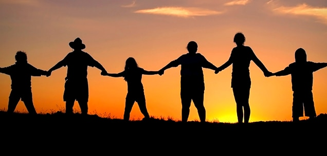Silhouette sunset family joining hands
