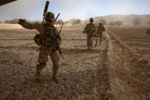 U.S. Marines with Bravo Company, 1st Battalion, 9th Marines (1/9) run towards a CH-53E Super Stallion assigned to Marine Heavy Helicopter Squadron 462 (HMH-462) at Gurjat Village, Helmand province, Afghanistan, Oct. 28, 2013. HMH-462 provided aerial support for 1/9 during an interdiction operation. (U.S. Marine Corps photo by Sgt. Gabriela Garcia/Released)