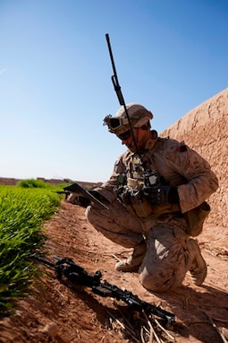 Cpl. Charles Kristel, a Schenectady, N.Y., native and team leader with 1st Battalion, 9th Marine Regiment, Regional Command (Southwest), radios another section of Marines during an interdiction operation in Helmand province, Afghanistan, Dec. 19, 2013. Kristel, an anti-tank missileman by trade, lead a section of infantry Marines during the clearing operation.