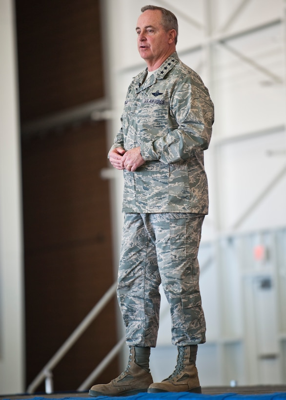 Air Force Chief of Staff Gen. Mark A. Welsh III, speaks to Airmen during a town-hall style meeting, April 7, 2014 at Nellis Air Force Base, Nev. Welsh, along with Chief Master Sgt. of the Air Force James A. Cody and their spouses, Betty and Athena, visited Nellis to thank Airmen and their families for their many contributions and sacrifices. (U.S. Air Force photo by Senior Airman Jason Couillard)