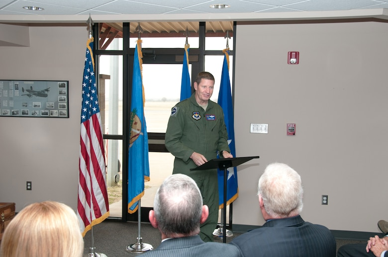 Gen. Robin Rand, commander of Air Education and Training Command, speaks to Enid, Okla., community leaders before presenting the city with the Altus Trophy April 2 at the Woodring Regional Airport in Enid. The Altus Trophy is presented to the civilian community that best supports its host AETC base. Enid received the trophy for the first time since the awards inception. (U.S. Air Force photo/Terry Wasson)