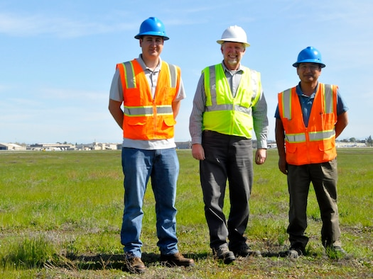 FORMER MCCLELLAN AIR FORCE BASE, Calif. -- From left, the Air Force Civil Engineer Center team of Mark Fossi, Paul Bernheisel and Gary Yuki monitor compliance at closed bases throughout the western region, like at MCClellan, in Sacramento, Calif. (U.S. Air Force photo/Scott Johnston)