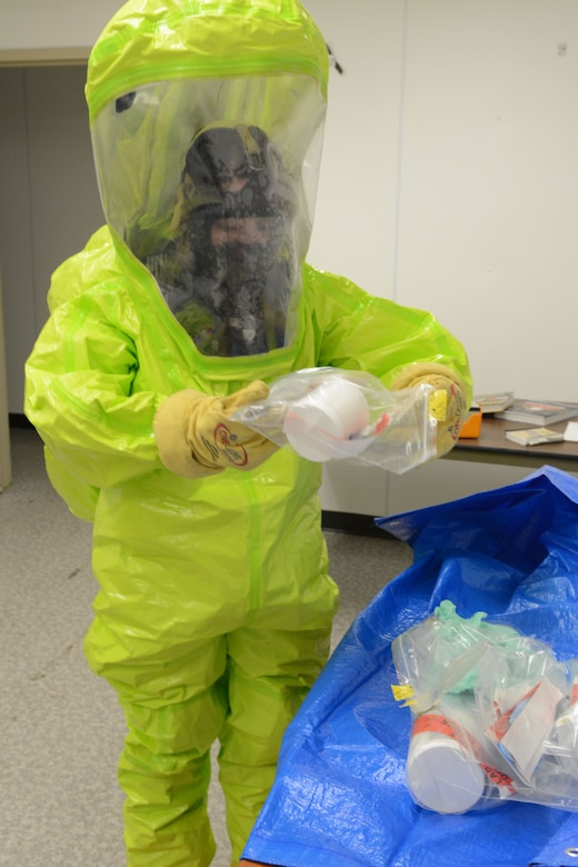 Senior Airman Sara Passint, 133rd emergency management, prepares to remove samples from a contaminated area during a field training exercise at Volk Field Air National Guard Base, Wis., April 4, 2014. Twenty-eight Airmen teamed up from six units for training that encompassed all hazard responses including radiation, chemical and biological situations. The training was part of emergency management's annual training requirement. (Air National Guard photo by Senior Airman Andrea F. Liechti)
