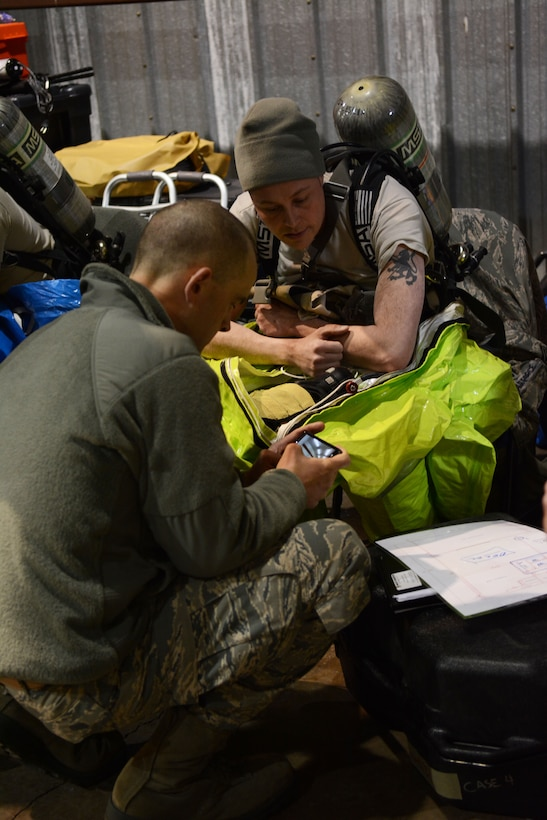 Tech. Sgt. Brian Black, 148th emergency management, briefs Staff Sgt. Ryan Dunlap, 127th emergency management on the objectives of the response prior to suiting up during a field training exercise at Volk Field Air National Guard Base, Wis., April 4, 2014. Dunlap was part of the second team to go into the training facility, so was responsible for gathering samples in the contaminated area during the exercise. The training exercise was part of emergency management's annual training requirement. (Air National Guard photo by Senior Airman Andrea F. Liechti)