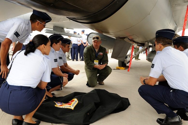 Lt. Col. Greg Pohoski, an F-16 instructor pilot with the 149th Fighter Wing, Texas Air National Guard, discusses flying operations with cadets from FACH (Fuerza Aerae de Chile), the Chilean air force, at FIDAE (Feria Internacional del Aire y del Espacio), an international trade exhibition air and space show, in Santiago, Chile, March 27, 2014. Pohoski was in Chile with members of the Texas Air National Guard for a subject matter expert exchange through the National Guard Bureau's State Partnership Program. (U.S. Air National Guard photo by Senior Master Sgt. Miguel Arellano / Released)