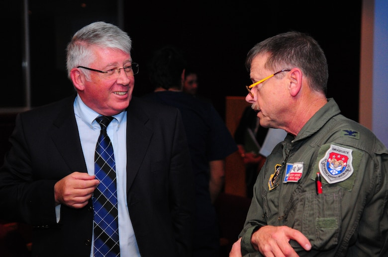 Maj. Gen. Charles Cunliffe (Ret.), Fuerza Aerea Chile (FACh) discusses emergency medical and aeromedical evacuation issues with Colonel Garrie Moore, Air Surgeon for the State of Texas, during a Subject Matter Expert (SME) exchange presentation March 24, 2014 at the FACh hospital in Santiago, Chile.  The SME exchange of information is part of the U.S. National Guard?s State Partnership Program (SPP) and is held during the annual Chilean FIDAE Air Show. (U.S. Air National Guard photo by Senior Master Sgt. Mike Arellano / Released)
