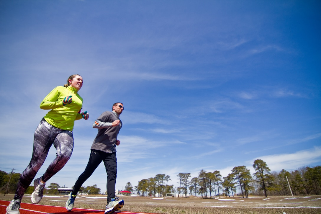 U.S. Air Force Staff Sgt. Alison Jones (left) and Tech. Sgt. Joseph Iovanisci (right) participate in the Third Annual 24 Hour Run Challenge to honor and remember fallen Tactical Air Control Party airmen at Atlantic City Air National Guard Base, N.J., March 27, 2014. Airmen from the New Jersey Air National Guard's 177th Fighter Wing, as well as civilians from the Federal Aviation Administration participated in the event. The 24 Hour Run Challenge is held at military bases all over the world.  Jones and Iovanisci are both assigned to the 227th Air Support Operations Squadron. Jones logged 30 miles during the challenge. (U.S. Air National Guard photo by Tech. Sgt. Matt Hecht/Released)