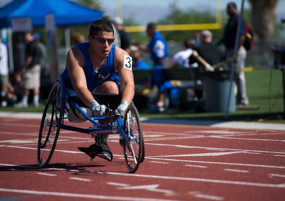 Staff sgt. Mark Johnson raced in a sprinting wheelchair during the track and field portion of the Air Force Trials April 8, 2014, at Rancho High School in Las Vegas, Nev. The Air Force Trials give injured, ill and wounded Airmen a chance to compete in Paralympic-style events.  (U.S. Air Force photo/Senior Airman Jette Carr)