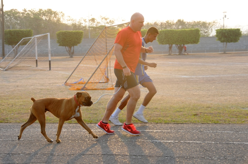 U.S. Army Col. Thomas Boccardi runs with Max (the Soto Cano fire department mascot) and a Honduran Air Force cadet during the 2nd Annual Wounded Warrior Project 24-Hour Relay. Service members from Joint Task Force-Bravo and the Honduran Air Force Academy participated in the 2nd Annual JTF-Bravo Wounded Warrior Project 24-hour relay April 4-5, 2014 at Soto Cano Air Base, Honduras. Nineteen teams consisting of 4, 6, 8 or 12 members ran or walked almost 2,180 miles to remember their injured brothers and sisters in service and to raise funds for the Wounded Warrior Project. A total of $6,000 has been raised by this event so far with more funds expected to be received. (Photo by U. S. Air National Guard Capt. Steven Stubbs)
