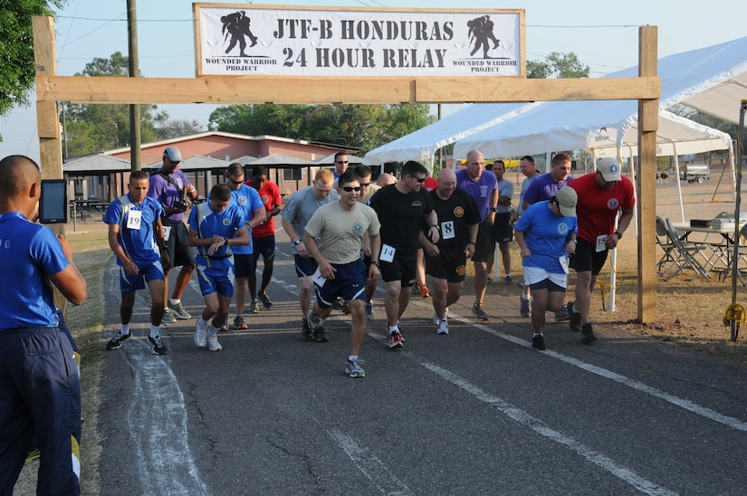 Service members from Joint Task Force-Bravo and the Honduran Air Force Academy participated in the 2nd Annual JTF-Bravo Wounded Warrior Project 24-hour relay April 4-5, 2014 at Soto Cano Air Base, Honduras. Nineteen teams consisting of 4, 6, 8 or 12 members ran or walked almost 2,180 miles to remember their injured brothers and sisters in service and to raise funds for the Wounded Warrior Project. A total of $6,000 has been raised by this event so far with more funds expected to be received. (Photo by U. S. Air National Guard Capt. Steven Stubbs)