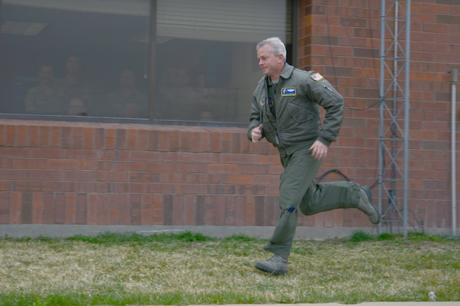 Master Sgt. Kurt Armstrong runs to the flight line following an alert given during an exercise April 6, 2014. (Air National Guard photo by Tech. Sgt. Kelly Collett/RELEASED)