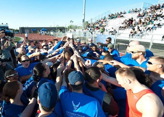 Wounded Warrior athletes huddle up for motivation and camaraderie before the track and field portion of the Air Force Wounded Warrior Team Trials April 8, 2014, at Rancho High School, Las Vegas. Adaptive athletic reconditioning helps wounded warriors build strength and endurance, while they draw inspiration from their team mates. (U.S. Air Force photo by Airman 1st Class Thomas Spangler)