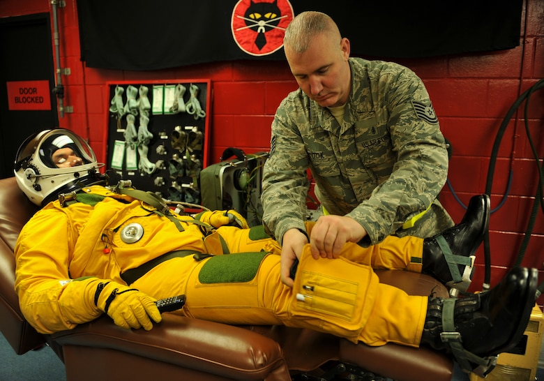 Maj. David (last name withheld due to operational security constraints), 5th Reconnaissance Squadron U-2 Dragon Lady pilot, has the final preparations made to his fully-pressurized suit before flying a mission at Osan Air Base, Republic of Korea, March 10, 2014. Members of the 5th RS's physiological support division help every U-2 pilot suit up and hook them up to pure oxygen prior to missions. (U.S. Air Force photo/Senior Airman Siuta B. Ika)