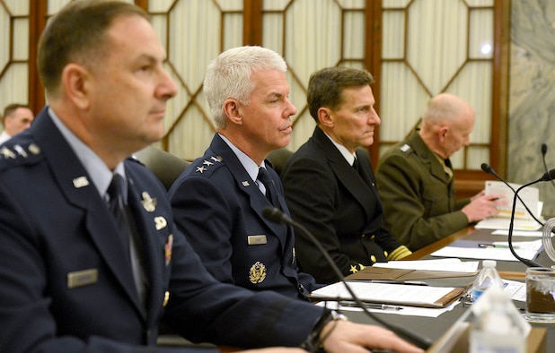 Lt. Gen. Charles R. Davis, second from left, testifies April 8, 2014, before the Senate Subcommittee on Air and Land in Washington, D.C.  Witnesses from other services at the hearing included Lt. Gen. Christopher C. Bogden, U.S. Air Force Program Executive officer, F-35 Lightning II Joint Program Office; Vice Adm. Paul A. Grosklags, Principal Military Deputy to the Assistant Secretary of the Navy for Research, Development and Acquisition; and Lt. Gen. Robert E. Schmidle Jr., Deputy Commandant of the Marine Corps for Aviation. Davis is the Military Deputy to the Assistant Secretary of the Air Force for Acquisition. (U.S. Air Force photo/Scott M. Ash)