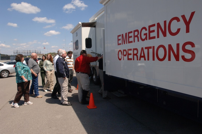 Representatives from local, state and federal agencies board a U.S. Army Corps of Engineers Emergency Command and Control Vehicle during a Silver Jackets meeting at Old Hickory Dam in Old Hickory, Tenn., April 9, 2014. The group learned about the capabilities of the Army's command and control asset.