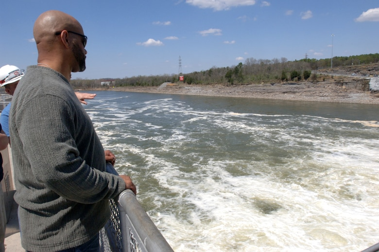 Richard Flood, a hazard mitigation specialist with the Federal Emergency Management Agency Region 4 Mitigation Division, watches turbulent waters below Old Hickory Dam while touring the project during a Silver Jackets meeting April 9, 2014.