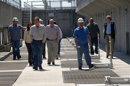 Dirk Cundiff (Left) and Chris Sherek (Third from right) lead a U.S. Army Corps of Engineers Nashville District tour of the Old Hickory Hydropower plant for local, state and federal participants of a Silver Jackets meeting at Old Hickory Dam in Old Hickory, Tenn., April 9, 2014. The hydropower plant is located on the Hendersonville, Tenn., side of the Cumberland River. Silver Jackets is a program that promotes cohesive solutions and synchronizes plans and programs between local, state and federal agencies.