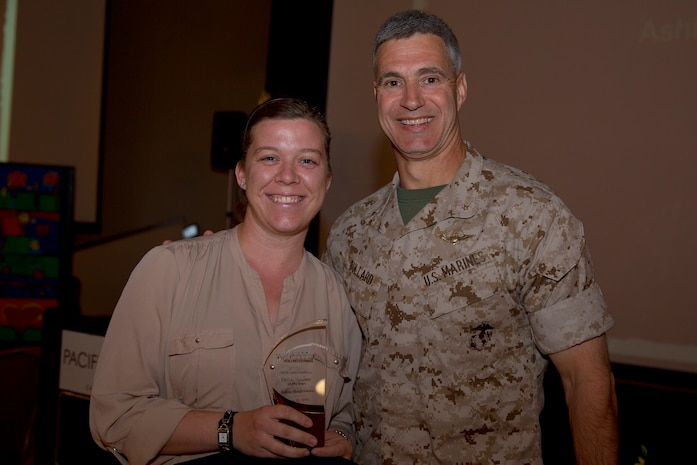 Ashley Hendricks, recipient of the Civilian Volunteer of the Year award, poses with Brig. Gen. John W. Bullard, commanding general of Marine Corps Installations-West, during the 2014 Volunteer Recognition Ceremony at the Pacific Views Event Center April 10. More than 6,000 military and civilian volunteers from several units on Camp Pendleton accumulated a total of 110,461 hours of volunteer service in 2013.