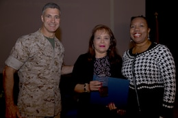 Representatives for Words of Comfort, Hope and Promise, the team awarded with the Team Volunteer of the Year award, pose with Brig. Gen. John W. Bullard, commanding general of Marine Corps Installations-West, during the 2014 Volunteer Recognition Ceremony at the Pacific Views Event Center April 10. More than 6,000 military and civilian volunteers from several units on Camp Pendleton accumulated a total of 110,461 hours of volunteer service in 2013.