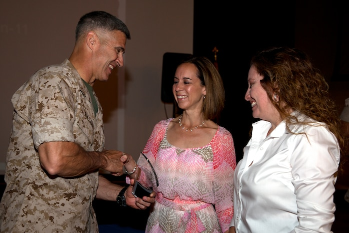 Representatives for Combat Logistics Battalion-11, the unit awarded with Small Unit Volunteer of the Year award, pose with Brig. Gen. John W. Bullard, commanding general of Marine Corps Installations-West, during the 2014 Volunteer Recognition Ceremony at the Pacific Views Event Center April 10.More than 6,000 military and civilian volunteers from several units on Camp Pendleton accumulated a total of 110,461 hours of volunteer service in 2013.