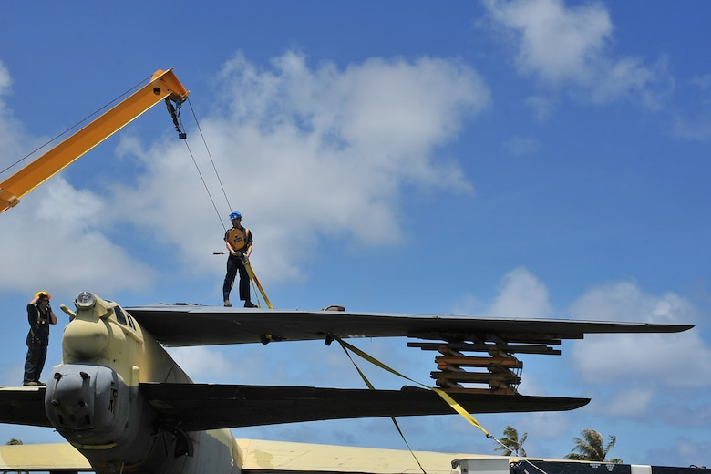"Airmen from the 36th Maintenance Squadron dismantle the vertical tail of the ""Old-100"" static display B-52D Stratofortress at Arc Light Memorial Park on Andersen Air Force Base, Guam, March 22, 2014. The aircraft is being removed due to irreparable deterioration.  The vertical tail section is being preserved and will play a key part in the redesigned memorial site at the park when the project is completed. (U.S. Air Force photo by Staff Sgt. Melissa B. White/Released)"