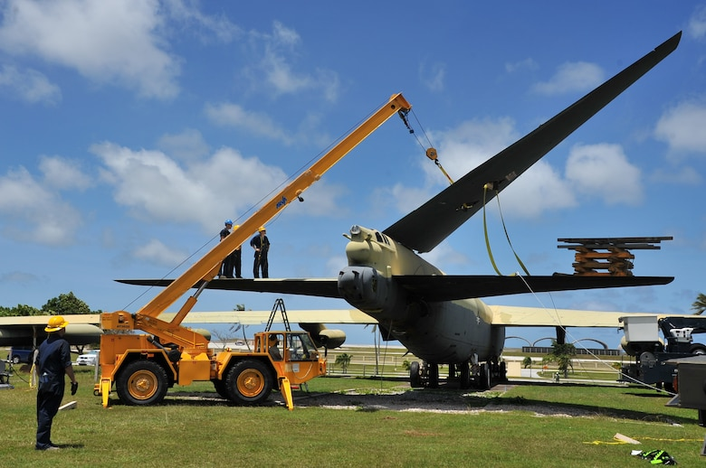 "Airmen from the 36th Maintenance Squadron dismantle the vertical tail section of the ""Old-100"" static display B-52D Stratofortress at Arc Light Memorial Park on Andersen Air Force Base, Guam, March 22, 2014. The aircraft is being removed due to irreparable damage from weather. The vertical tail section is being preserved and will be part of redesigned memorial when the project is completed. (U.S. Air Force photo by Staff Sgt. Melissa B. White/Released)"