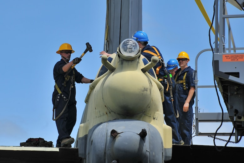 "Airmen from the 36th Maintenance Squadron prepare to dismantle the vertical tail section of the ""Old-100"" static display B-52D Stratofortress at Arc Light Memorial Park on Andersen Air Force Base, Guam, March 22, 2014. The aircraft is being removed due to irreparable deterioration from weather after being on display for more than 30 years. This is the second B-52 at Arc Light Park that has suffered the effects of corrosion on Guam. (U.S. Air Force photo by Staff Sgt. Melissa B. White/Released)"