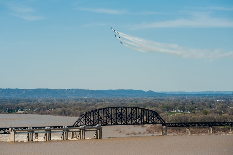 The U.S. Navy Blue Angels practice their aerial demonstration routine over the Ohio River in downtown Louisville, Ky., April 10, 2014. The Blue Angels are performing in this weekend's Thunder Over Louisville air show. (U.S. Air National Guard photo by Maj. Dale Greer))