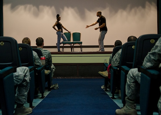 "Sakinah Iman and Derante Parker, ""Sex Signals"" actors, perform a scenario March 26, 2014, on Andersen Air Force Base, Guam. The 90-minute show included discussion on varied topics such as dating, rape, consent, alcohol, and intervention. (U.S. Air Force photo by Senior Airman Katrina M. Brisbin/Released)"