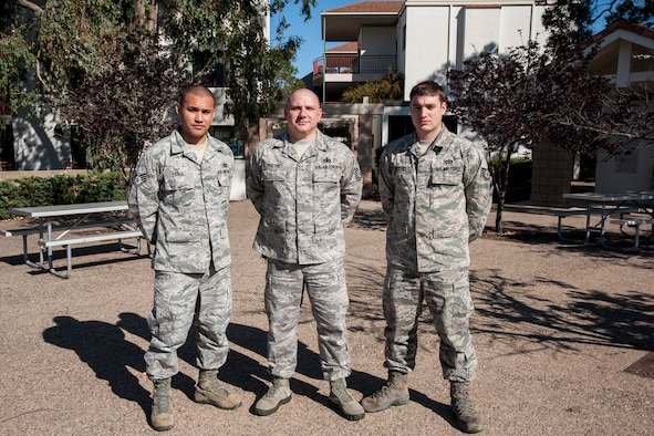 (From left) Staff Sgt. Jarrett Pablo, 30th Civil Engineer Squadron airmen dormitory leader, Master Sgt. William Proctor, 30th CES unaccompanied housing superintendent, and Staff Sgt. Lance Russell, 30th CES airmen dormitory leader, pose for a group photo April 9, 2014, Vandenberg Air Force Base, Calif.  The ADLs strive to provide a modern, functional, well-maintained and comfortable home, as well as promote pride, professionalism and personal dignity. (U.S. Air Force photo/Airman 1st Class Yvonne Morales)