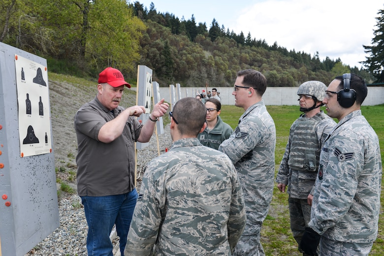 Richard Jette, 627th Security Forces Squadron combat arms instructor, reveals common mistakes shooters make when attempting to accurately fire the M-4 carbine rifle to McChord Field Airmen at Range 108 next to North Fort Lewis, April 9, 2014 at Joint Base Lewis-McChord, Wash. Combat arms instructors are taught how to recognize problems Airmen have while conducting live fire so corrections can be made to reinforce good shooting habits. (U.S. Air Force photo/ Staff Sgt. Russ Jackson)