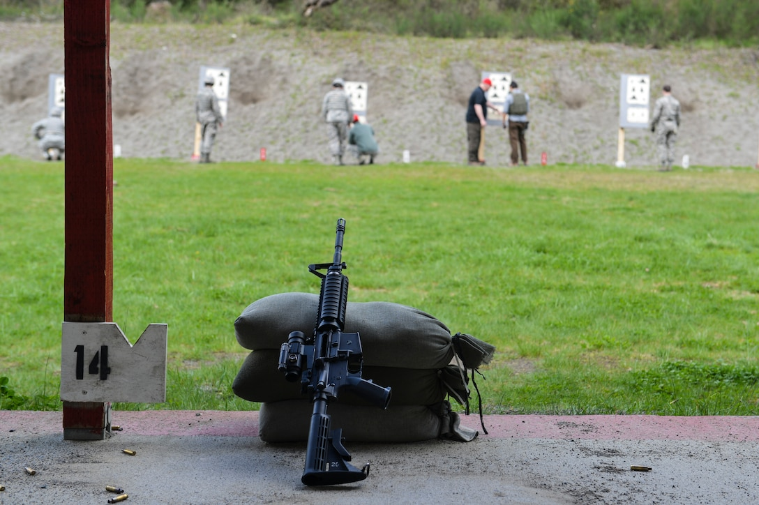 Combat arms instructors review zeroing corrections with McChord Field Airmen individually before they can qualify on the M-4 carbine rifle at Range 108 next to North Fort Lewis, April 9, 2014 at Joint Base Lewis-McChord, Wash. While most of their time is concentrated on the firing range, combat arms instructors inspect and repair weapons, schedule classes, and manage munitions accounts, spare parts and hazardous material issues. (U.S. Air Force photo/ Staff Sgt. Russ Jackson)