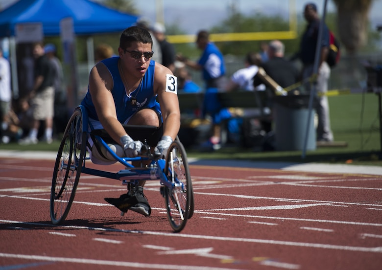 Staff Sgt. Mark Johnson raced in a sprinting wheelchair during the track and field portion of the Air Force Trials on April 8, 2014, at Rancho High School in Las Vegas, Nev. The Air Force Trials give injured, ill and wounded Airmen a chance to compete in Paralympic-style events. (U.S. Air Force photo/Senior Airman Jette Carr)
