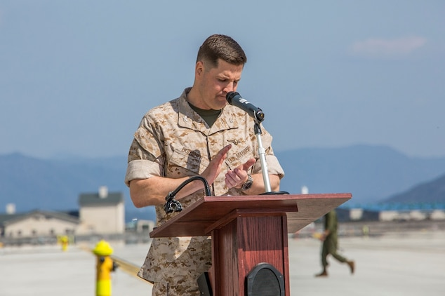 Col. Robert V. Boucher, commanding officer of Marine Corps Air Station Iwakuni, Japan, gives his opening remarks during Marine Aircraft Group 12 and Marine Aviation Logistics Squadron 12 ribbon cutting ceremony on the flight line aboard station March 27, 2014. The ribbon cutting ceremony symbolized the formal opening of the new facilities.